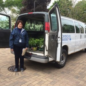 Cathy N of Dominican University with the van of native plants!